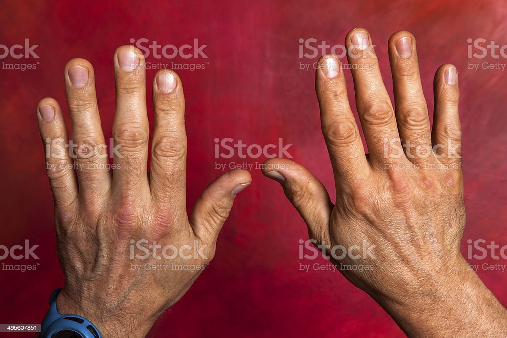 Male hands on a red background, stock photo