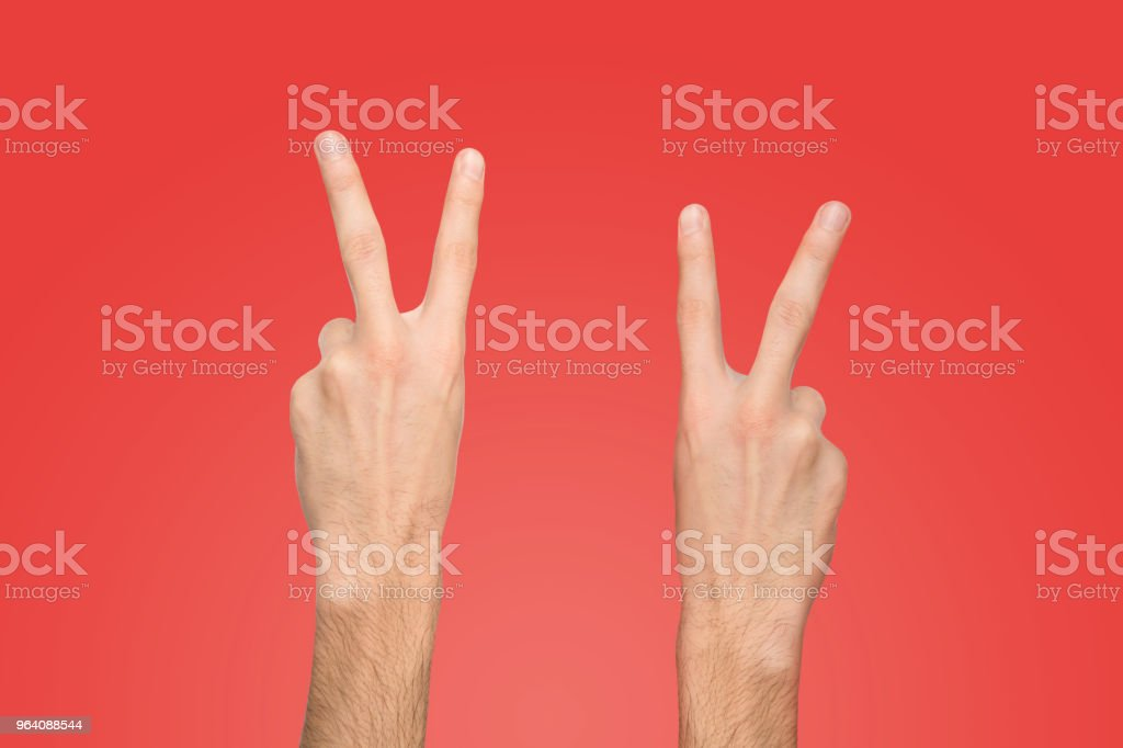 Male hands shows number two on red background - Royalty-free Adult Stock Photo