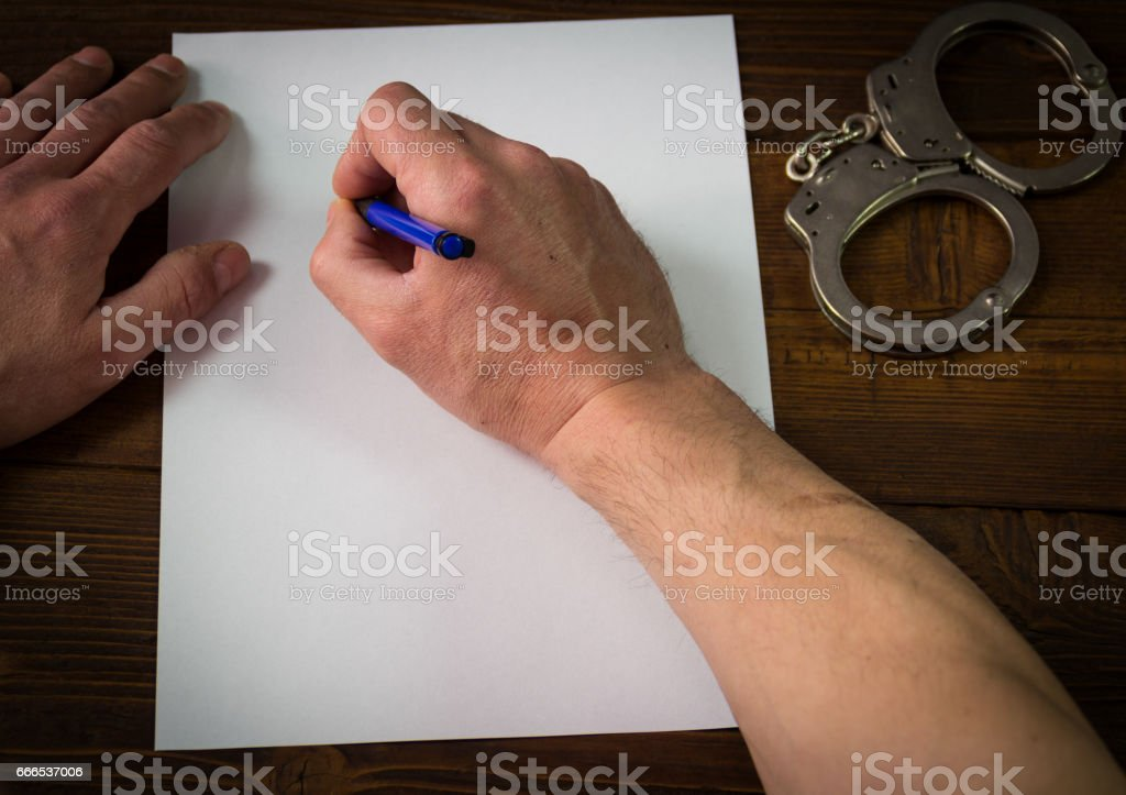 Male hands signing confession, top view stock photo