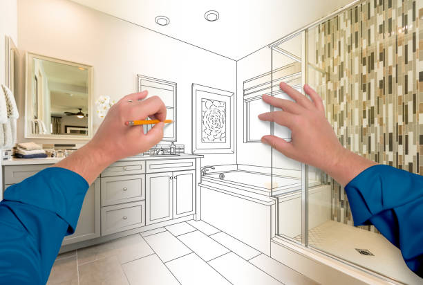 Male Hands Sketching Beautiful Custom Bathroom Gradating to Finished Construction stock photo