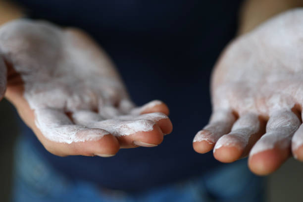 Male hands smeared with magnesium powder ready to workout stock photo