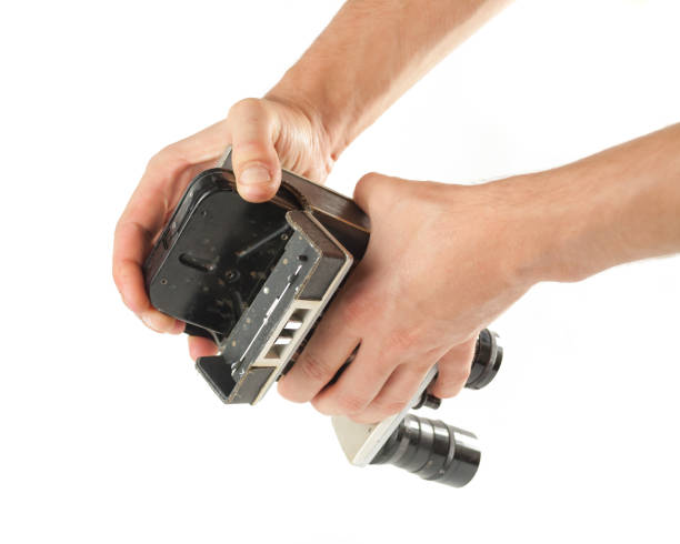 Male hands taking out a tape from an old camcorder stock photo