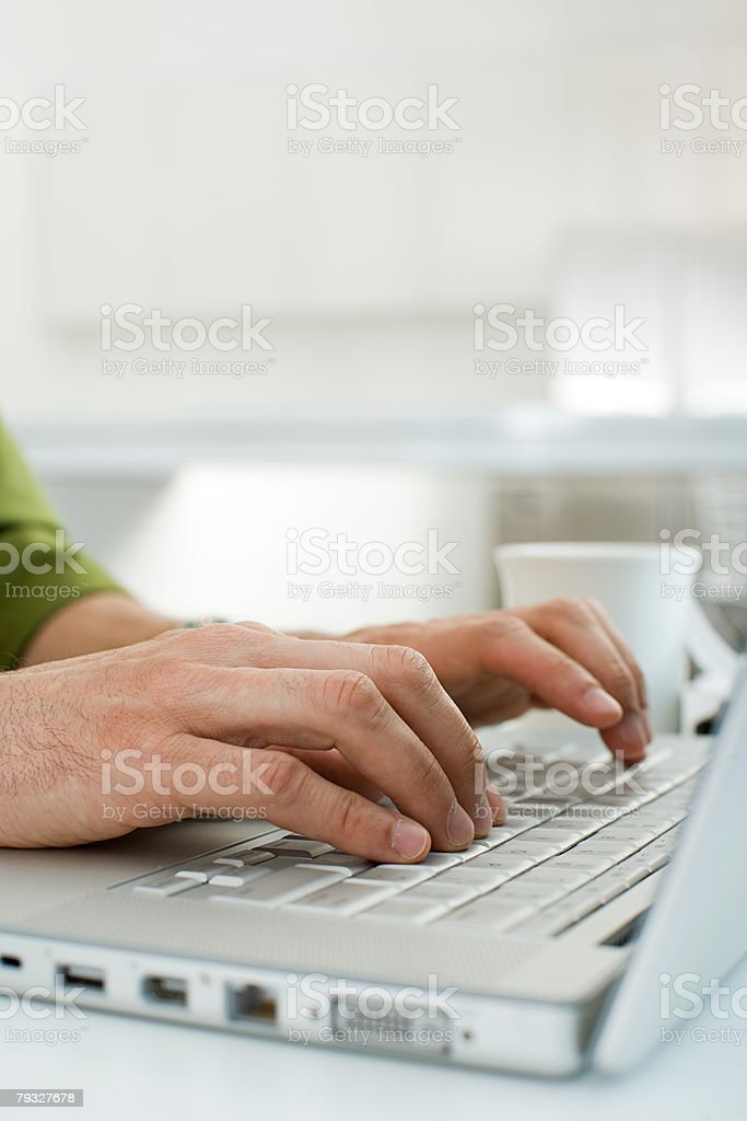 Male hands typing on a laptop computer 免版稅 stock photo