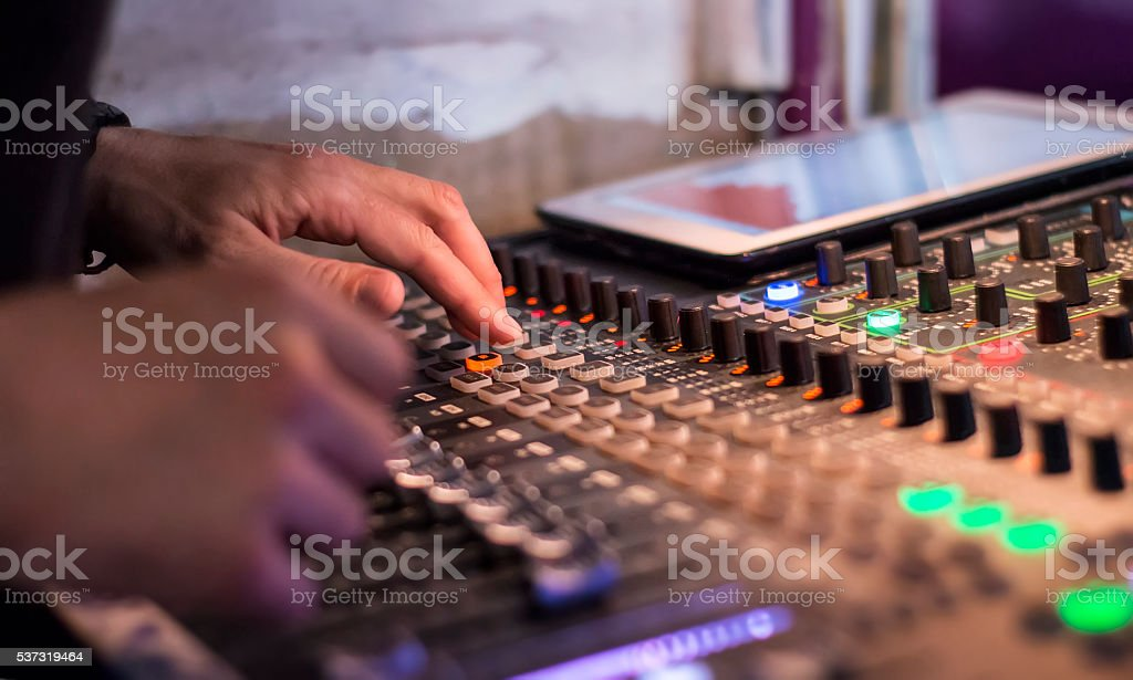 Male hands using a sound digital mixer at a concert stock photo