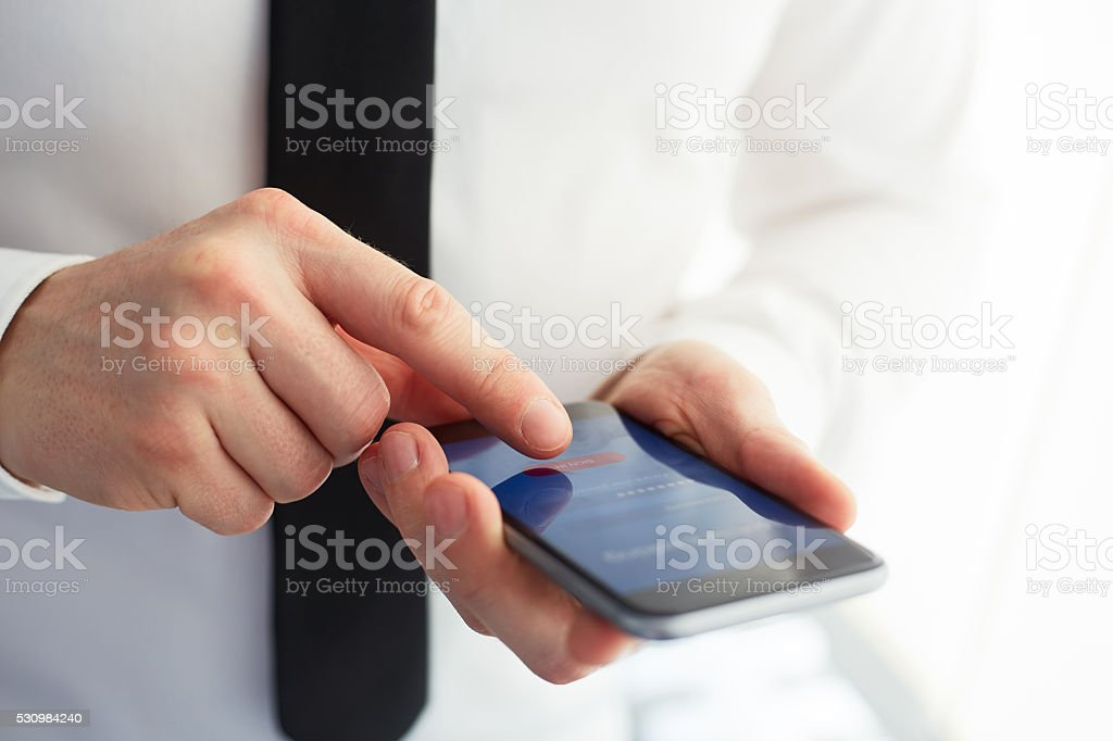 Male hands using mobile banking stock photo