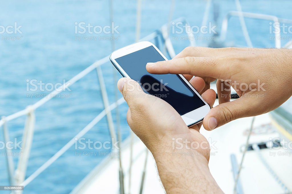 Male hands using smart phone stock photo