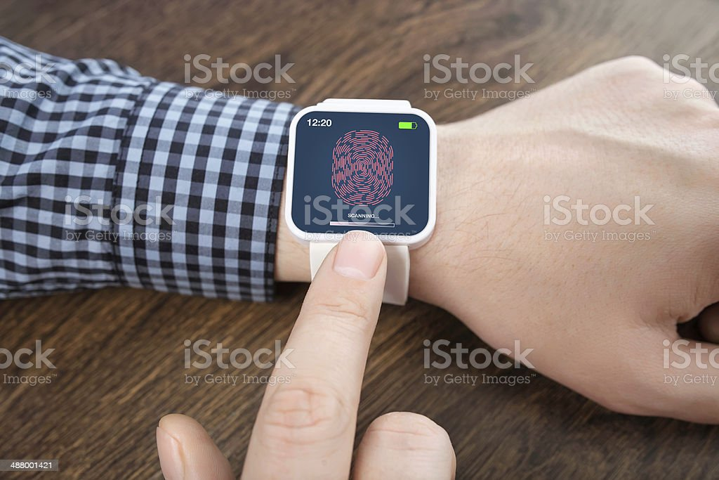 male hands white smartwatch with a fingerprint - Royalty-free Adult Stock Photo