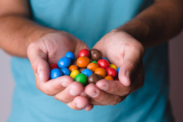 Male hands with candies. stock photo