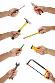 istock Male hands with lots of house improvement tools 527517469