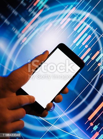 641839870 istock photo Male hands with smartphone in front of a digital display with financial information. Blank empty screen. Mock up 1188433345