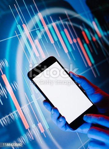 641839870 istock photo Male hands with smartphone in front of a digital display with financial information. Blank empty screen. Mock up 1188433380