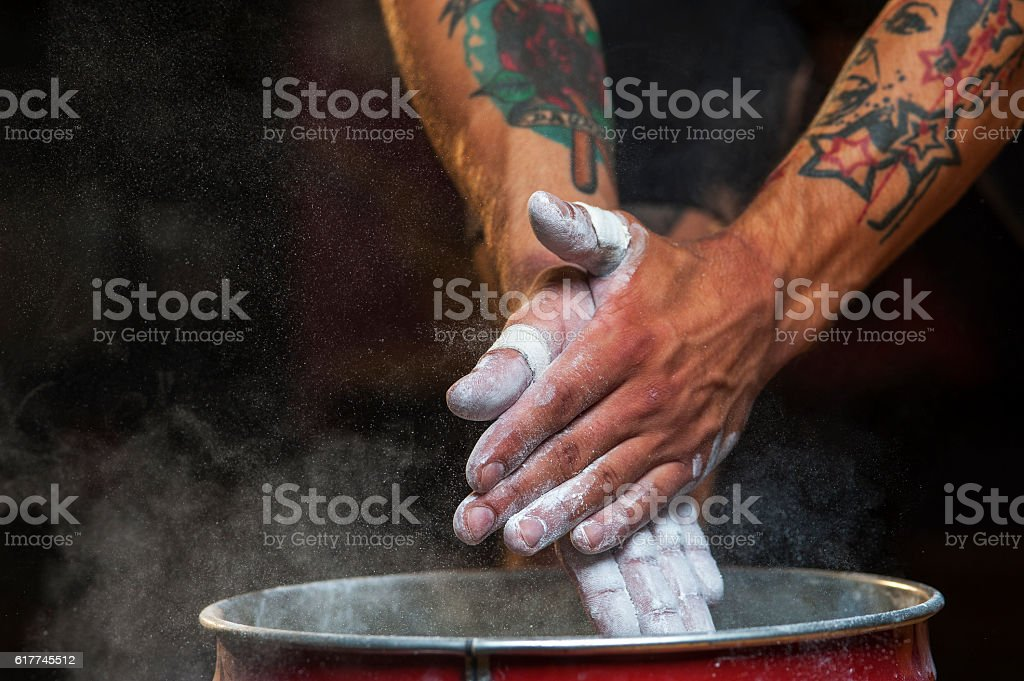 Male hands with talc powder. stock photo