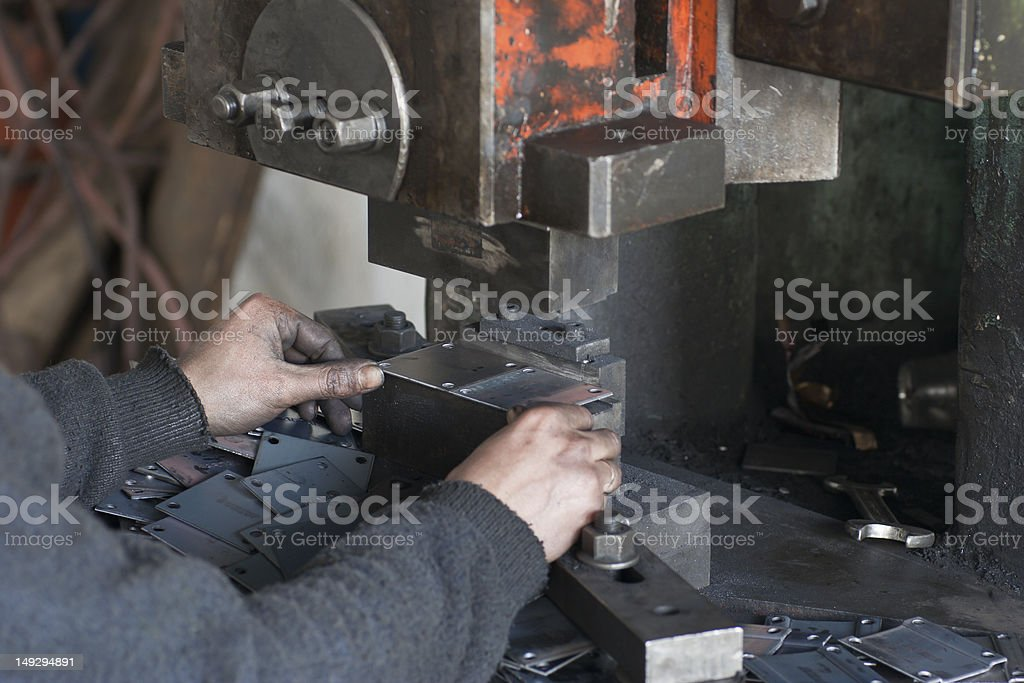 Male Hands Working on Press stock photo