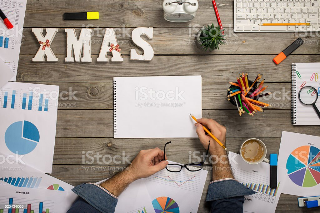Male hands writing in notebook, top view stock photo