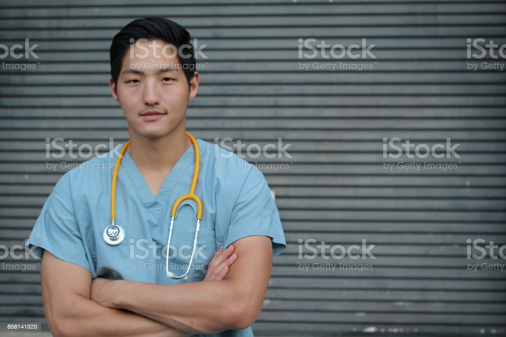 Male health care worker crossing his arms stock photo