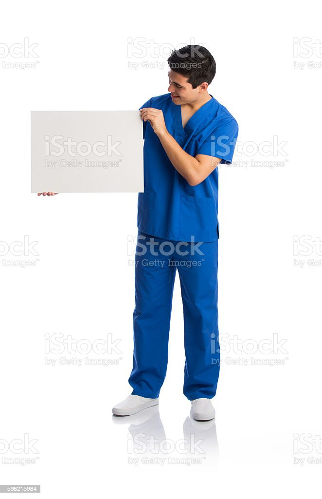 Male health care worker holding sign and looking at it foto royalty-free
