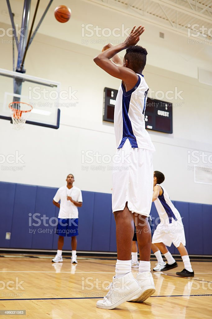 Male High School Basketball Player Shooting A Free Throw stock photo
