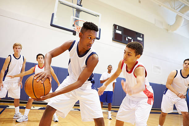 Male High School Basketball Team Playing Game stock photo