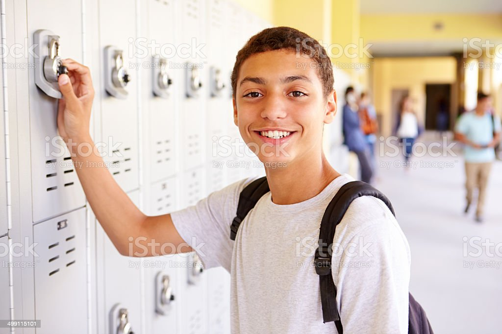 Male High School Student Opening Locker stock photo