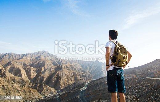 Male hiker enjoying the mountain range view