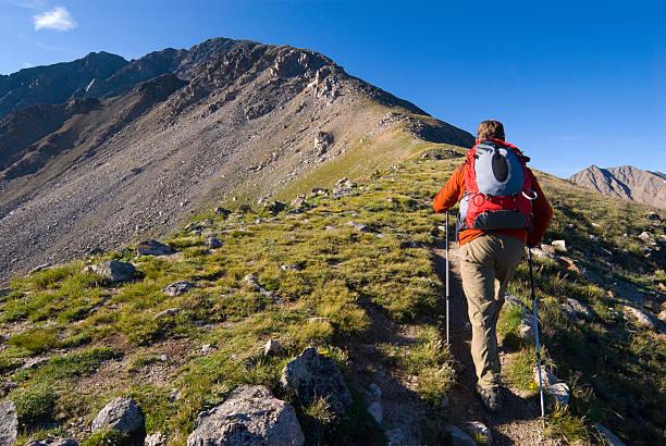 Male Hiker Hiking High on Trail 14er Mountain Peak stock photo