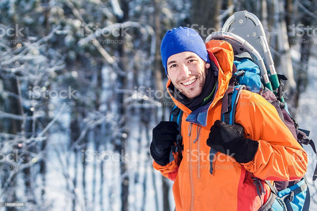 A male hiker hiking outdoors in winter stock photo