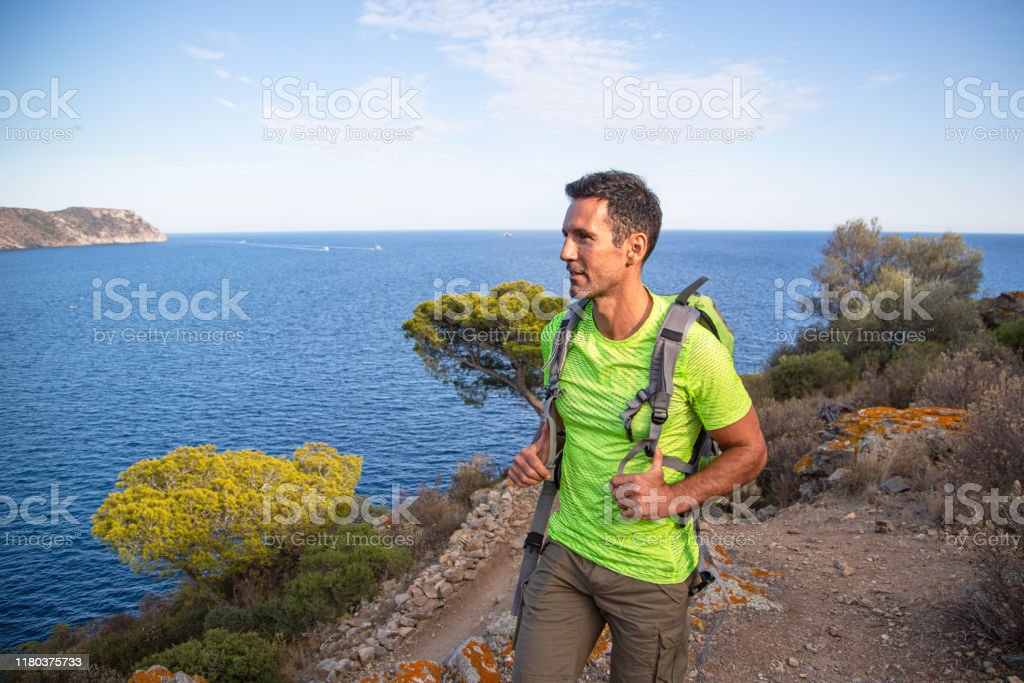 Male Hiker In His 40s Out Trekking Along Coastal Path Mediterranean Sea Spain Stock Photo Download Image Now Istock