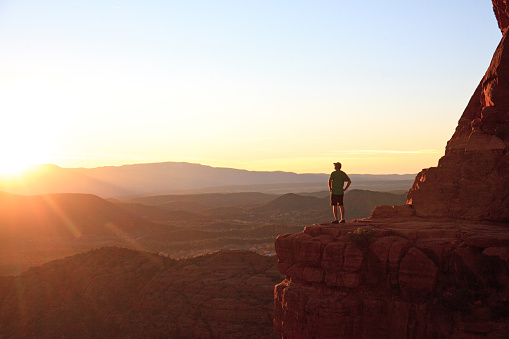 Male Hiker In Sedona At Dramatic Viewpoint At Sunset Stock Photo - Download Image Now