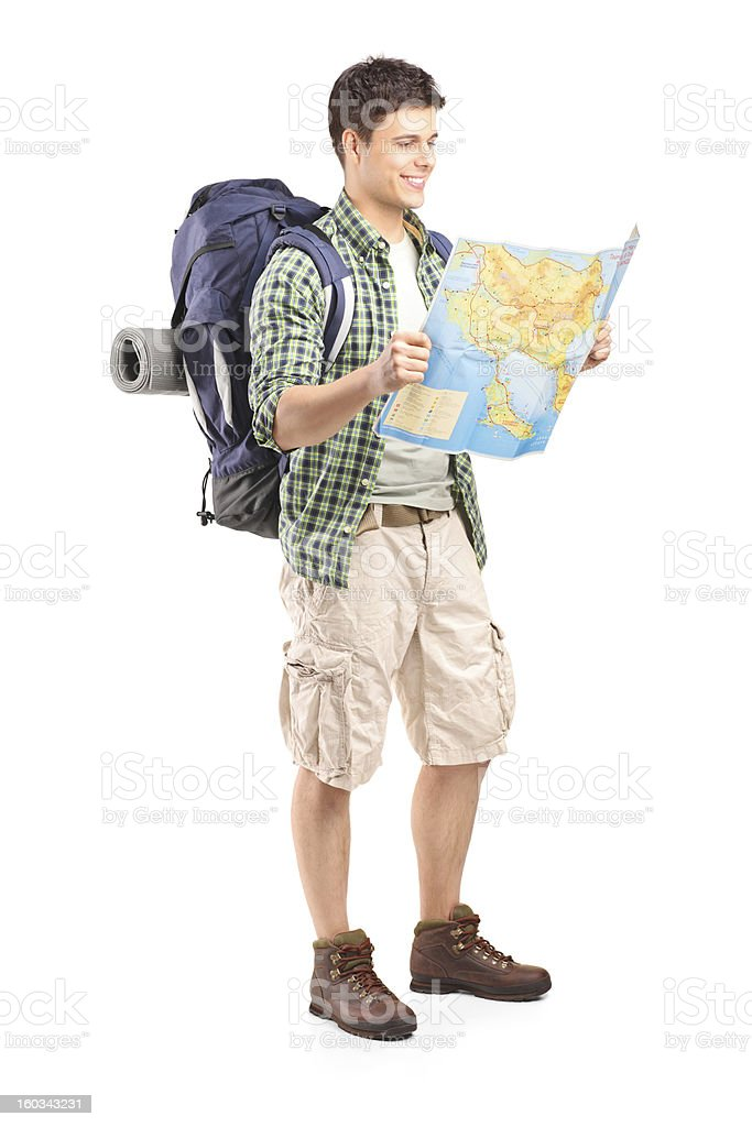 Male hiker looking at map stock photo
