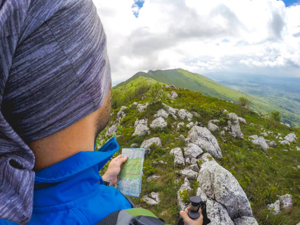 Male Hiker on top of mountain stock photo