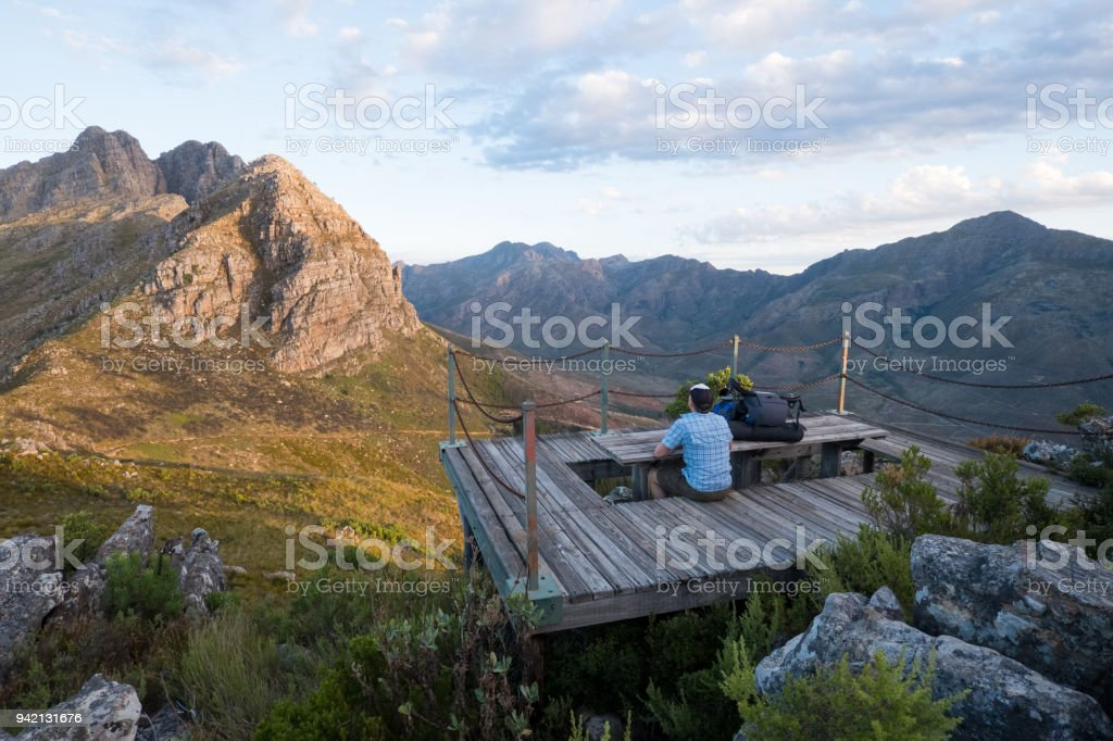 Male hiker spending time in nature stock photo