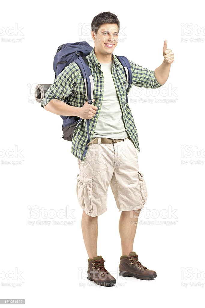 Male hiker with backpack giving a thumb up royalty-free stock photo