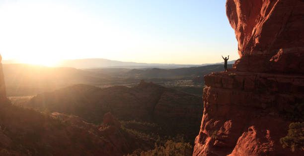 Male Hiker Worship Silhouette in Sedona stock photo