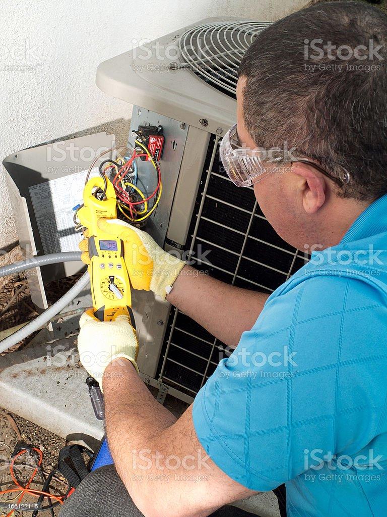 Male hispanic air-conditioning maintenance technician stock photo