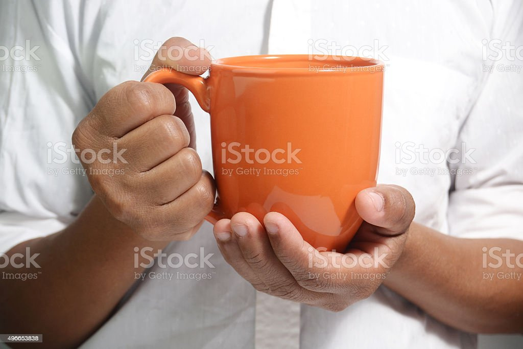 male holding cup of coffee stock photo