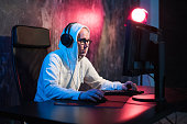istock male hooded gamer playing online game on pc computer 1077718346