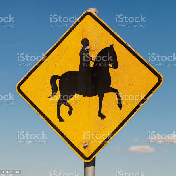 Male horse rider sign against blue sky australian signs found along picture id1132897076?b=1&k=6&m=1132897076&s=612x612&h=tmqjk2xyjygwjmhrhmmp nv3crpkqy unr2tde cgzu=