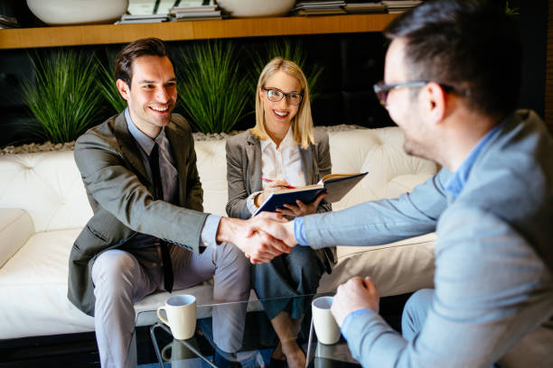 Male HR manager shaking hands with job applicant stock photo