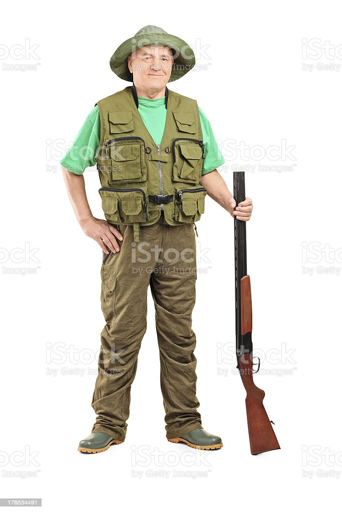 Male hunter holding a shotgun royalty-free stock photo