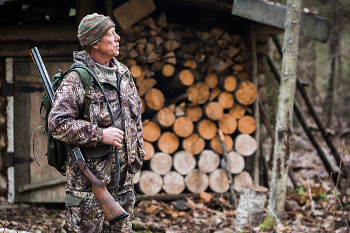 Male hunter in the forest