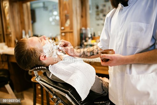 622527180istockphoto Male in barber shop 591993134