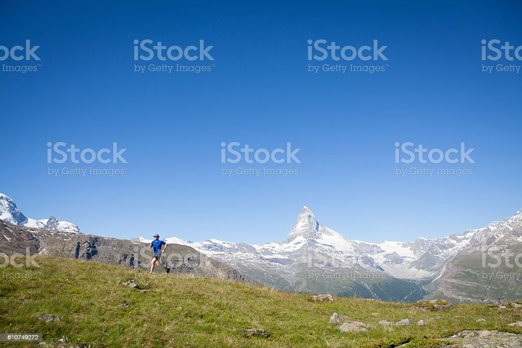 Male in blue on an adventure stock photo