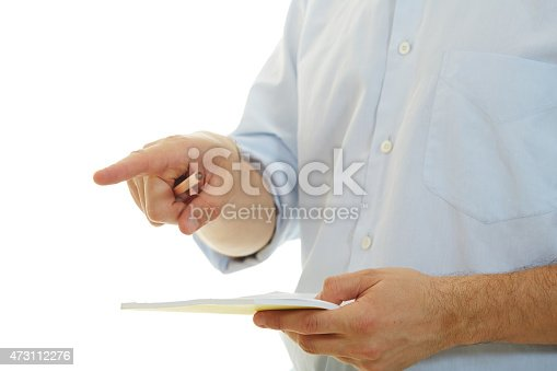 1175668510 istock photo Male in blue shirt taking notes on white background 473112276