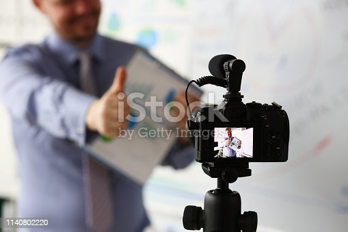 815359538 istock photo Male in suit and tie show confirm sign 1140802220