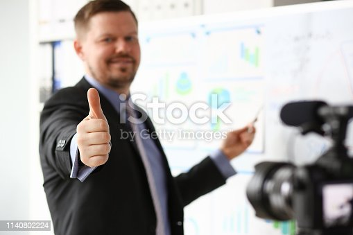 815359538 istock photo Male in suit and tie show confirm sign 1140802224