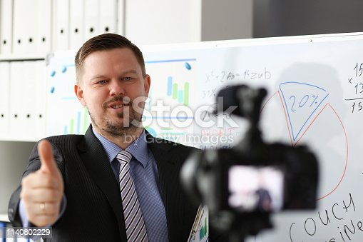 815359538 istock photo Male in suit and tie show confirm sign 1140802229