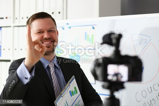 815359538 istock photo Male in suit and tie show confirm sign 1140802232