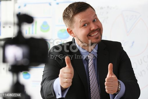 815359538 istock photo Male in suit and tie show confirm sign 1140802244
