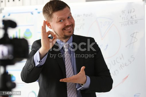 815359538 istock photo Male in suit and tie show confirm sign 1140802245