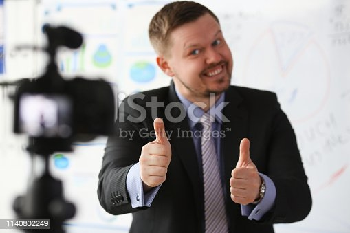 815359538 istock photo Male in suit and tie show confirm sign 1140802249